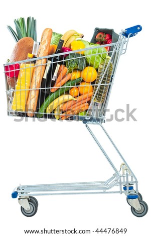 A side view of a shopping cart full of groceries on a white background