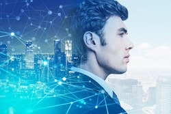 A side view portrait of a young businessman. A chart of neural network showing interconnections between business partners all over the world. New York city on background. Double exposure