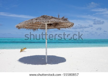 A sight from a sunshade upon an overwhelming beach