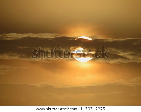 A sight of sunset, the sun is hiding behind the clouds to beautify itself.          #1170712975