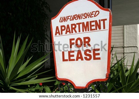 A sign advertising an unfurnished apartment for lease.