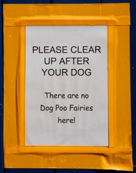 A sign asking dog owners to clean up after their animals