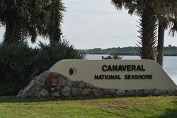 A sign designates the entrance to Canaveral National Seashore, USA.