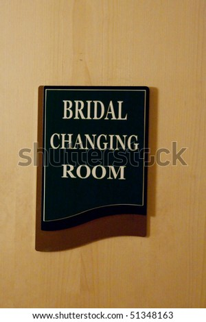 A sign for a bridal changing room on a door.