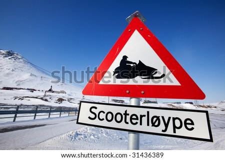 A sign for a snowmobile trail in Longyearbyen, Spitsbergen, Svalbard, Norway