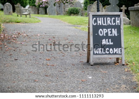 A sign for an open church for all welcome to visit