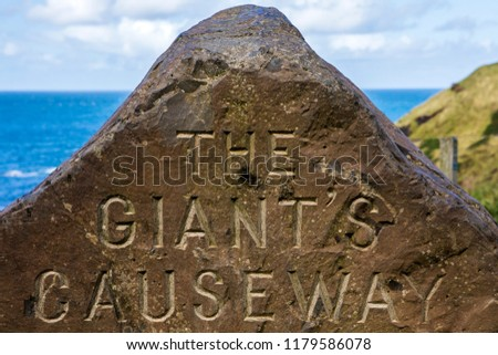 A sign for the Giant's Causeway in Northern Ireland etched into a rock. #1179586078