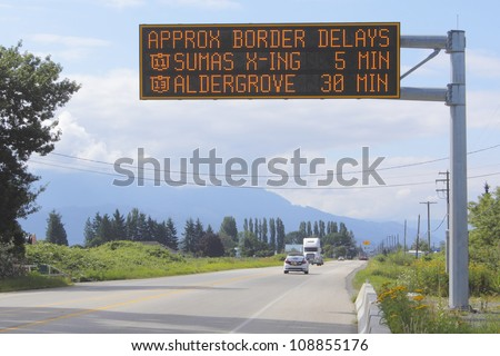 A sign indicates wait time at the British Columbia and Washington State border crossing/Wait Time Signage/A sign indicates wait time at the British Columbia and Washington State border crossing