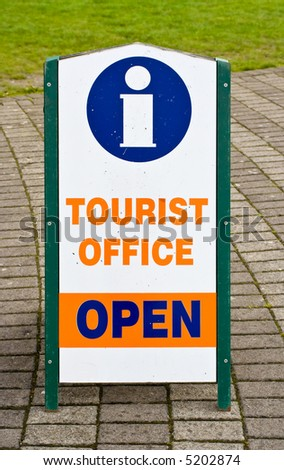 A sign indicating that a tourist office is open. The symbol for information is also shown on the sign.