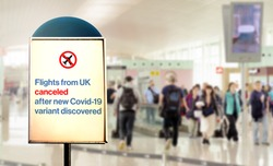 a sign inside an airport warns of the cancellation of flights form UK after new Covid-19 variant discover. Airport security measures and travel restrictions. Corona virus pandemic