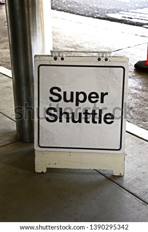 A Sign of Super Shuttle waiting zone. stock photo
