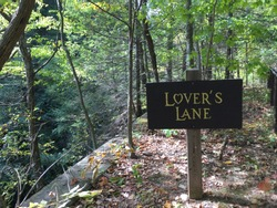 A sign on a hiking trail