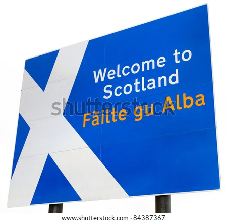 "A sign on the border crossing to Scotland from England.  Contains the Scottish flag and ""Welcome to Scotland"" in English and Gaelic.  Isolated on a white background."
