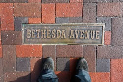 A sign on the ground labels Bethesda Avenue, a popular street for shopping and restaurants in the Chevy Chase neighborhood in Montgomery County.