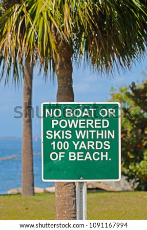 A Sign Saying No Boat or Powered Skis Within 100 Yards of Beach #1091167994