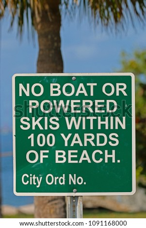 A Sign Saying No Boat or Powered Skis Within 100 Yards of Beach #1091168000