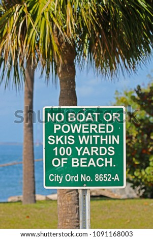 A Sign Saying No Boat or Powered Skis Within 100 Yards of Beach #1091168003