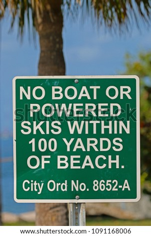 A Sign Saying No Boat or Powered Skis Within 100 Yards of Beach #1091168006