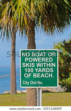 A Sign Saying No Boat or Powered Skis Within 100 Yards of Beach #1091168009