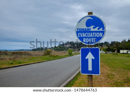A sign showing a Tsunami Evacuation Route near the Pacific Ocean in Washington, USA