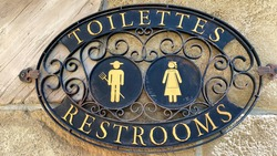 A sign signifying the mens and womens restroom entrance.