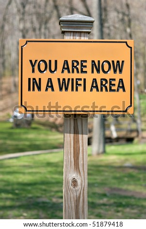 A sign that reads YOU ARE NOW IN A WIFI AREA indicating a wireless hotspot for internet use.