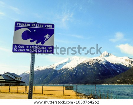 A sign warns of tsunami danger zone.