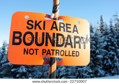 A sign warns skiers and snowboarders that the are they are about to enter is out of bounds and not patrolled.