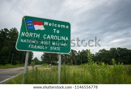 A sign welcomes residents and visitors to the US state of North Carolina.