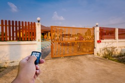 A signal of remote control show when person open automatic gate at home,motor automatic gate is home security system.
