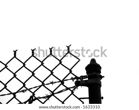 A silhouette of a barbed wire fence with copy space
