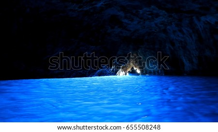 Shutterstock A silhouette of a boat at the exit of Blue grotto cave, Capri, Italy