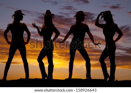 A silhouette of a cowgirl in many poses with a beautiful sky behind her. - stock photo