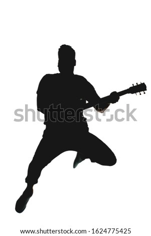 A silhouette of a guitarist jumping with an electric guitar on a white background with a clipping mask