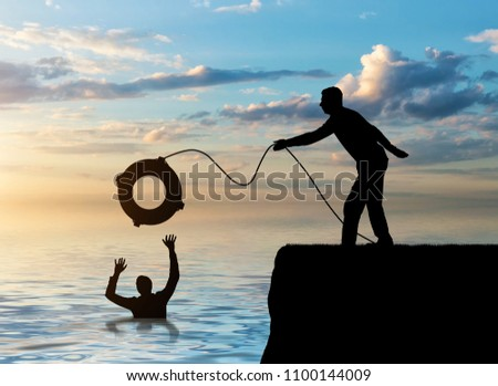 A silhouette of a man throws a lifeline to another man who is drowning in the water. The concept of mutual assistance in a business team Stockfoto ©