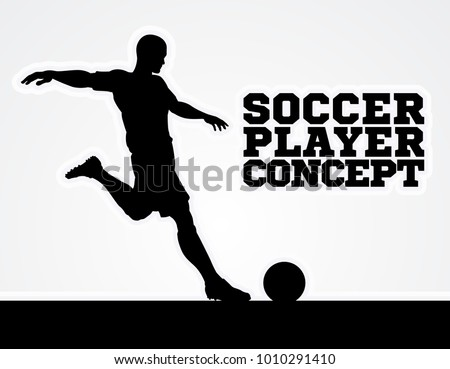 A silhouette of a soccer football player about to kick the ball