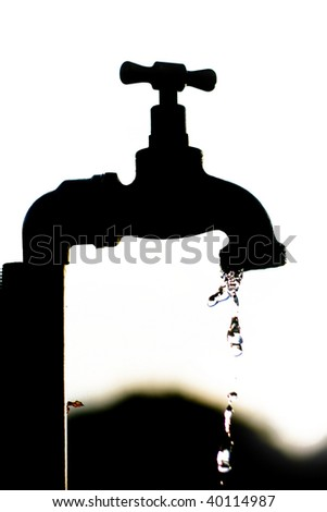 A Silhouette of a tap dripping water
