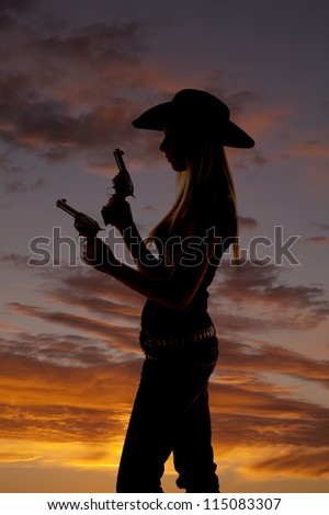 A silhouette of a woman holding on to her two pistols.
