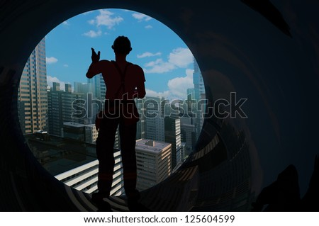 A silhouette of a worker in the tube.