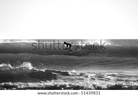 A Silhouette of Surfer in the Ocean