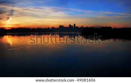stock-photo-a-silhouetted-panoramic-view-of-the-kansas-city-skyline-which-is-located-in-the-great-plains-area-49081606.jpg