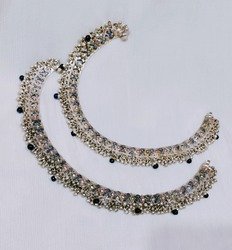 A Silver anklet with fascinating blue pearl and colourful stones embedded with it of an Indian style jewelery