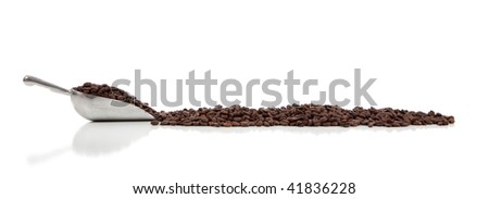 A silver scoop with whole coffee beans on  a white background with copy space - stock photo