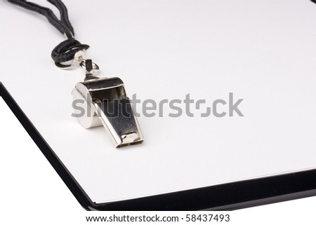 A silver whistle with a black string laying on a clipboard with white paper. Add your text to the background.