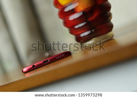 A simple Pic of a phone which contains red, orange and yellow as a primary color