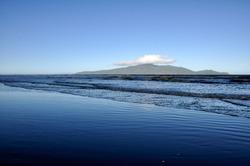 a single cloud on top of kapiti island
