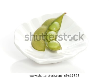A Single Edamame Pod, Open to Expose the Soy Beans Inside, Sitting on a Beautiful, White Plate
