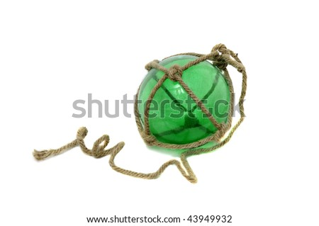 A Single glass fishing buoy used to keep fishing nets floating. This is an old glass antique. They use plastic ones now. Isolated on white background.