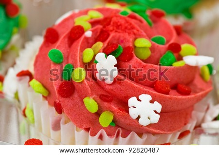 A Single Red Cupcake with Sprinkles