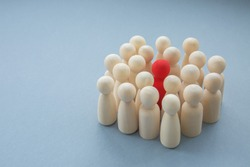 A single red person surrounded by others in a diversity or infectious disease image
